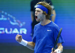 Andrey Rublev of Russia celebrates his victory over Adrian Mannarino of France in the final match of the Kremlin Cup tennis tournament in Moscow, Russia, Sunday, Oct. 20, 2019. (AP Photo/Alexander Zemlianichenko)
