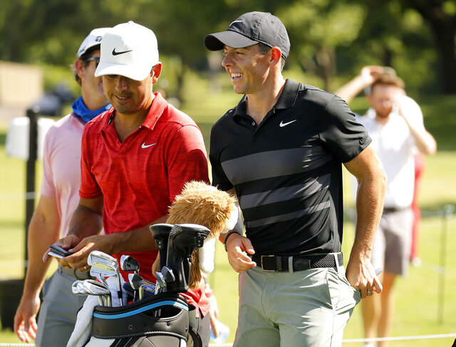 Rory McIlroy, right, smiles during practice for the Charles Schwab Challenge golf tournament at the Colonial Country Club in Fort Worth, Texas, Tuesday, June 9, 2020. The Challenge is the first PGA tour event since the COVID-19 pandemic began. (Tom Fox/The Dallas Morning News via AP)