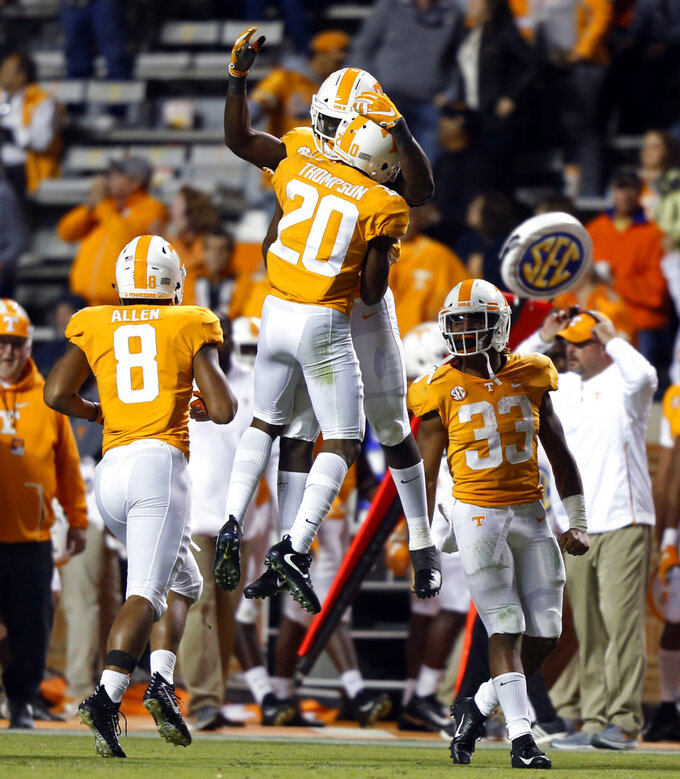 Tennessee defensive back Bryce Thompson (20) celebrates an interception with a teammate in the second half of an NCAA college football game Saturday, Nov. 3, 2018, in Knoxville, Tenn. Tennessee won 14-3. (AP Photo/Wade Payne)