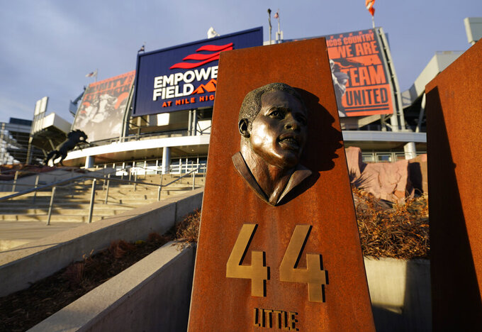 Sun illuminates the bust of Denver Broncos running back and Pro Football Hall of Famer Floyd Little late Saturday, Jan. 2, 2021, in the team's Ring of Fame plaza outside Empower Field at Mile High in Denver. Little, who was the franchise's sole star during years of struggles in the 1960s and 1970s, died at 78 from a rare form of cell cancer in Las Vegas. (AP Photo/David Zalubowski)