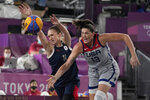 Anastasiia Logunova (11), of the Russian Olympic Committee, and United States' Stefanie Dolson (13) chase a loose ball during a women's 3-on-3 gold medal basketball game at the 2020 Summer Olympics, Wednesday, July 28, 2021, in Tokyo, Japan. (AP Photo/Jeff Roberson)