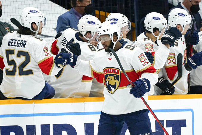 Florida Panthers left wing Anthony Duclair (91) celebrates after scoring a goal against the Nashville Predators in the second period of an NHL hockey game Tuesday, April 27, 2021, in Nashville, Tenn. (AP Photo/Mark Humphrey)