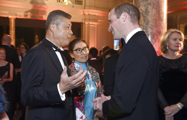 FILE - In this file photo taken Wednesday, Nov. 30, 2016, Chinese Ambassador to the United Kingdom, Liu Xiaoming, left, speaks with Britain's Prince William, Duke of Cambridge during the Tusk Conservation Awards at Victoria and Albert Museum in London. The Chinese Embassy in the United Kingdom has demanded that Twitter investigate after its ambassador's official account liked a pornographic post on the social media platform. (Stuart C. Wilson/Pool Photo via AP, File)