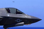 FILE - In this June 20, 2021, file photo, a U.S. F-35 aircraft sits on the U.K.'s aircraft carrier HMS Queen Elizabeth in the Mediterranean Sea. Japan's Defense Ministry's defense budget released on Tuesday, Aug. 31, 2021, is asking for a 2.6% increase over this year's budget including 130 billion yen ($1.18 billion) to acquire a dozen more U.S.-made F-35 stealth fighters from Lockheed Martin, including four F-35Bs. (AP Photo/Petros Karadjias, File)