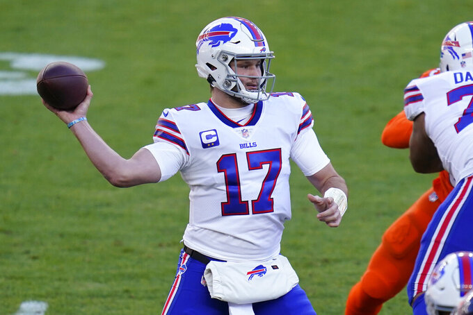 Buffalo Bills quarterback Josh Allen throws a pass during the first half of an NFL football game against the Denver Broncos, Saturday, Dec. 19, 2020, in Denver. (AP Photo/Jack Dempsey)