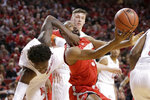 Nebraska's Nana Akenten, left, fouls Ohio State's Keyshawn Woods (32) during the second half of an NCAA college basketball game in Lincoln, Neb., Saturday, Jan. 26, 2019. Ohio State won 70-60. (AP Photo/Nati Harnik)