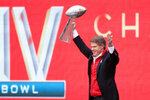 Kansas City Chiefs owner Clark Hunt holds the Super Bowl trophy during a rally in Kansas City, Mo., Wednesday, Feb. 5, 2020. (AP Photo/Orlin Wagner)