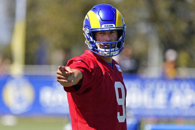 Los Angeles Rams quarterback Matthew Stafford signals during practice at NFL football training camp Wednesday, July 28, 2021, in Irvine, Calif. (AP Photo/Marcio Jose Sanchez)