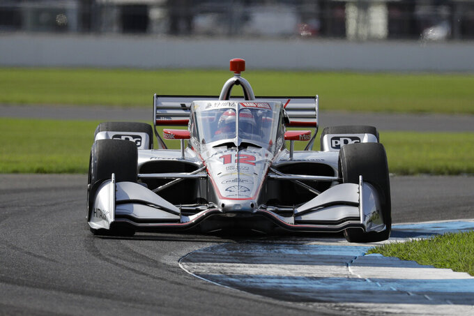 Race driver Will Power, of Australia, drives through a turn during qualifying for the IndyCar auto race at Indianapolis Motor Speedway in Indianapolis, Friday, July 3, 2020. (AP Photo/Darron Cummings)