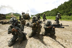 "FILE - In this July 6, 2016, file photo, South Korean and U.S. marines aim their machine guns during a joint military exercise between the two countries in Pohang, South Korea. U.S. President Donald Trump promised to end ""war games"" with South Korea, calling them provocative, after meeting North Korean leader Kim Jong Un on June 12, 2018. His announcement appeared to catch both South Korea and the Pentagon by surprise. (Kim Joon-bum/Yonhap via AP, File)"
