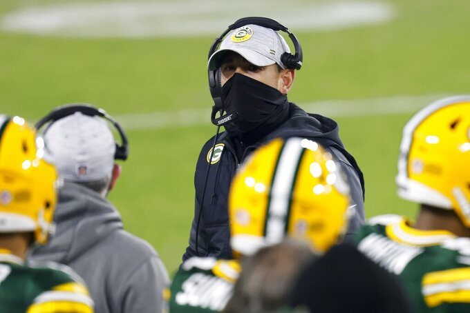 Green Bay Packers head coach Matt LaFleur is seen on the sidelines during the first half of an NFL football game against the Carolina Panthers Saturday, Dec. 19, 2020, in Green Bay, Wis. (AP Photo/Matt Ludtke)
