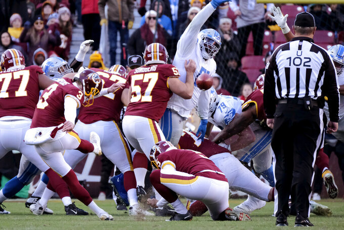 Washington Redskins kicker Dustin Hopkins (3) kicks a field goal against the Detroit Lions during the second half of an NFL football game, Sunday, Nov. 24, 2019, in Landover, Md. (AP Photo/Mark Tenally)