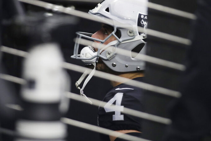 Las Vegas Raiders quarterback Derek Carr (4) waits before entering the field before an NFL football game against the Indianapolis Colts, Sunday, Dec. 13, 2020, in Las Vegas. (AP Photo/Isaac Brekken)