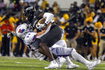 Southern Mississippi wide receiver Demarcus Jones, top, is tackled by Louisiana Tech linebacker Tyler Grubbs during an NCAA college football game in Hattiesburg, Miss., Saturday, Sept. 19, 2020. (Cam Bonelli/Hattiesburg American via AP)