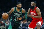 Boston Celtics' Kyrie Irving (11) drives past Houston Rockets' James Harden during the first half of an NBA basketball game in Boston, Sunday, March 3, 2019. (AP Photo/Michael Dwyer)