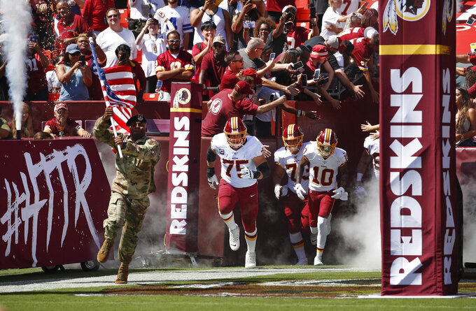 Members of the Washington Redskins take the field before the start of the first half of an NFL football game against Dallas Cowboys, Sunday, Sept. 15, 2019, in Landover, Md. (AP Photo/Alex Brandon)