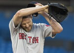 Boston Red Sox starting pitcher Chris Sale reacts on the mound after giving up a two-run home run to Toronto Blue Jays' Danny Jansen in the fourth inning of a baseball game in Toronto, Wednesday, July 3, 2019. (Fred Thornhill/The Canadian Press via AP)