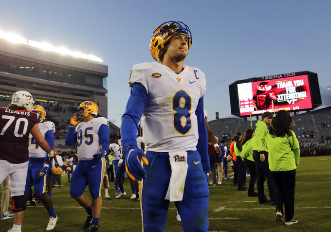 Pittsburgh quarterback Kenny Pickett (8) leaves the field after an NCAA college football game against Virginia Tech, Saturday, Oct. 16, 2021, in Blacksburg, Va. (Matt Gentry/The Roanoke Times via AP)