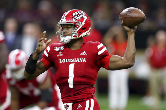 Louisiana-Lafayette quarterback Levi Lewis (1) throws a pass in the first half of an NCAA college football game against Mississippi State in New Orleans, Saturday, Aug. 31, 2019. (AP Photo/Chuck Cook)