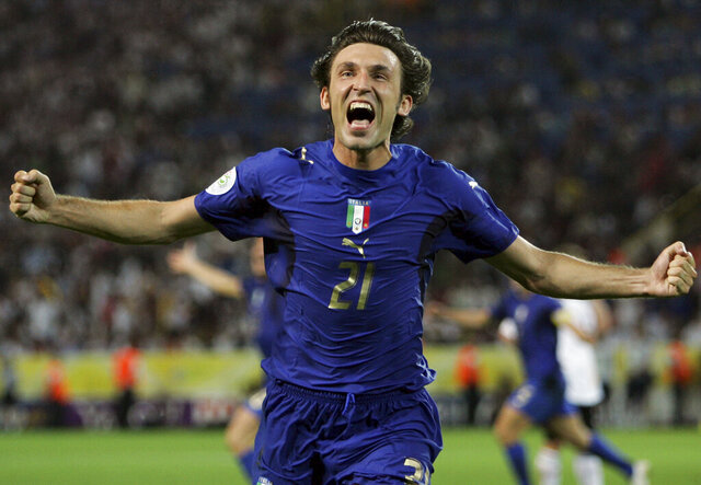FILE - In this Tuesday, July 4, 2006 filer, Italy's Andrea Pirlo celebrates his side's first goal by teammate Fabio Grosso in the extra time of the semifinal World Cup soccer match between Germany and Italy in Dortmund, Germany. World Cup winner Pirlo was named Thursday, July 30, 2020, coach of Juventus' under-23 team, which plays in Serie C. (AP Photo/Andrew Medichini, File)