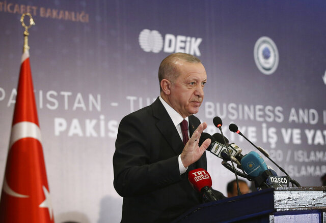 Turkey's President Recep Tayyip Erdogan addresses a Pakistan-Turkey business forum, in Islamabad, Pakistan, Friday, Feb. 14, 2020. Erdogan is in Pakistan for a two-day state visit. (Presidential Press Service via AP, Pool)