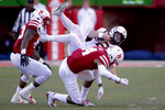 Nebraska defensive back Tre Neal (14) tackles Minnesota quarterback Tanner Morgan (2) during the second half of an NCAA college football game in Lincoln, Neb., Saturday, Oct. 20, 2018. (AP Photo/Nati Harnik)