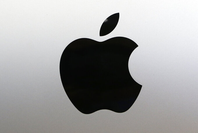FILE - In this Aug. 7, 2017 file photo, the Apple logo at a store in Hialeah, Fla. The European Commission said Friday, Sept. 25, 2020 it's appealing a court decision that Apple doesn't have to repay 13 billion euros ($15 billion) in back taxes to Ireland. The appeal comes after the U.S. tech giant scored a decisive recent legal victory in its longrunning battle with the European Union's executive Commission, which has been trying to rein in multinationals' ability to strike special tax deals with individual EU countries.  (AP Photo/Alan Diaz, File)
