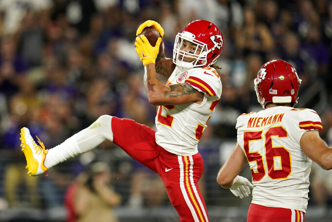 Kansas City Chiefs free safety Tyrann Mathieu, left, intercepts a pass attempt in front of teammate Ben Niemann in the first half of an NFL football game against the Baltimore Ravens, Sunday, Sept. 19, 2021, in Baltimore. (AP Photo/Julio Cortez)