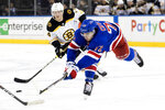 New York Rangers center Filip Chytil (72) and Boston Bruins right wing Chris Wagner (14) chase a loose puck in the second period of an NHL hockey game, Wednesday, Feb. 6, 2019, at Madison Square Garden in New York. (AP Photo/Mary Altaffer)