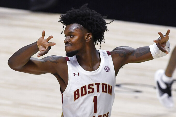 Boston College's CJ Felder gestures after scoring a three-point basket in the first half of an NCAA college basketball game against St. John's, Monday, Nov. 30, 2020, in Uncasville, Conn. (AP Photo/Jessica Hill)
