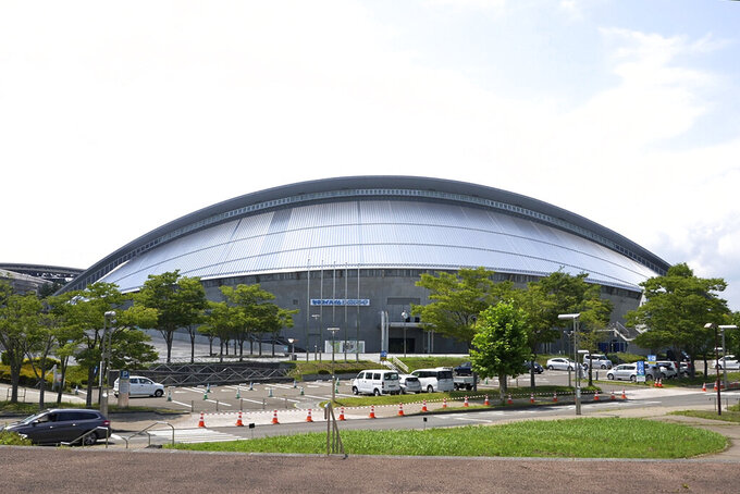 """This photo shows Sekisui Heim Super Arena, which was used as a morgue after the 2011 earthquake, also known as the Great East Japan Earthquake, in Rifu, Japan, Thursday, July 29, 2021. The Tokyo Olympics was billed as the """"Recovery and Reconstruction Games,"""" with the torch relay starting in disaster-hit Fukushima and several events held in Fukushima and Miyagi. However, the coronavirus pandemic has disrupted opportunities to showcase the region's restoration to foreign spectators. (AP Photo/Chisato Tanaka)"""