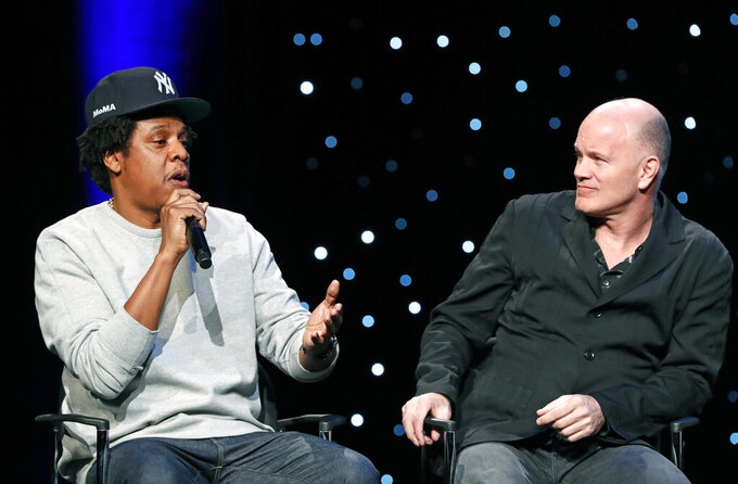 "Rapper and business mogul Shawn ""Jay-Z"" Carter, left, speaks as Michael Novogratz, founder and CEO Galaxy Digital, listens during the launch of a partnership among entertainment moguls, recording artists, business and sports leaders who hope to transform the American criminal justice system, Wednesday, Jan. 23, 2019, in New York. The group, called the Reform Alliance, will be led by Van Jones, a CNN host, activist and former adviser to President Barack Obama. (AP Photo/Kathy Willens)"