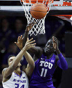 TCU forward Lat Mayen (11) rebounds against Kansas State forward Levi Stockard III (34) during the first half of an NCAA college basketball game in Manhattan, Kan., Saturday, Jan. 19, 2019. (AP Photo/Orlin Wagner)