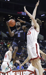 Saint Louis' Tramaine Isabell Jr. (2) drives past Davidson's Luka Brajkovic (35) during the second half of an NCAA college basketball game in the semifinal round of the Atlantic 10 men's tournament Saturday, March 16, 2019, in New York. Saint Louis won 67-44. (AP Photo/Frank Franklin II)
