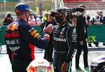 Mercedes driver Lewis Hamilton of Britain, right, speaks with Red Bull driver Max Verstappen of the Netherlands after the qualifying session prior to the Formula One Grand Prix at the Spa-Francorchamps racetrack in Spa, Belgium Saturday, Aug. 29, 2020. Hamilton will start in pole position for the race on Sunday. (Francois Lenoir, Pool via AP)