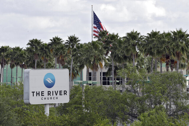 FILE - This Monday, March 30, 2020 file photo shows The River Church in Tampa, Fla. Pastor Rodney Howard-Browne was arrested Monday, March 30, 2020, for violating a county order by hosting a large number of congregants at the church. (AP Photo/Chris O'Meara)