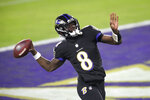 Baltimore Ravens quarterback Lamar Jackson pretends to throw the ball into the stands after scoring a touchdown on a keeper against the Dallas Cowboys during the first half of an NFL football game, Tuesday, Dec. 8, 2020, in Baltimore. (AP Photo/Nick Wass)