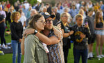 Attendees hug during a vigil Friday, Sept. 6, 2019, in Santa Barbara, Calif., for the victims who died aboard the dive boat Conception. The Sept. 2 fire took the lives of 34 people on the ship off Santa Cruz Island off the Southern California coast near Santa Barbara. (AP Photo/Mark J. Terrill)