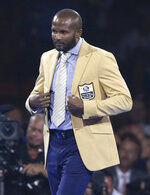 Champ Bailey, a member of the Pro Football Hall of Fame Class of 2019, wears his gold jacket during the gold jacket dinner in Canton, Ohio, Friday, Aug. 2, 2019. (Scott Heckel/The Canton Repository via AP)