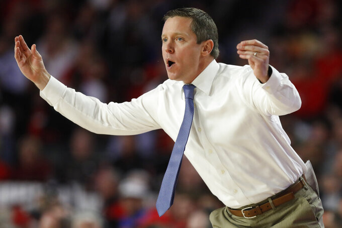 Florida coach Mike White gestures during the half of the team's NCAA college basketball game against Georgia on Wednesday, March 4, 2020, in Athens, Ga. (Joshua L. Jones/Athens Banner-Herald via AP)