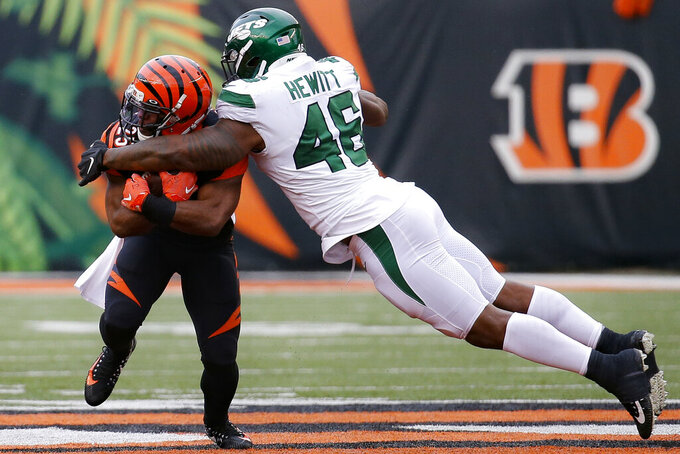 Cincinnati Bengals running back Giovani Bernard (25) runs the ball against New York Jets linebacker Neville Hewitt (46) during the second half of an NFL football game, Sunday, Dec. 1, 2019, in Cincinnati. (AP Photo/Frank Victores)