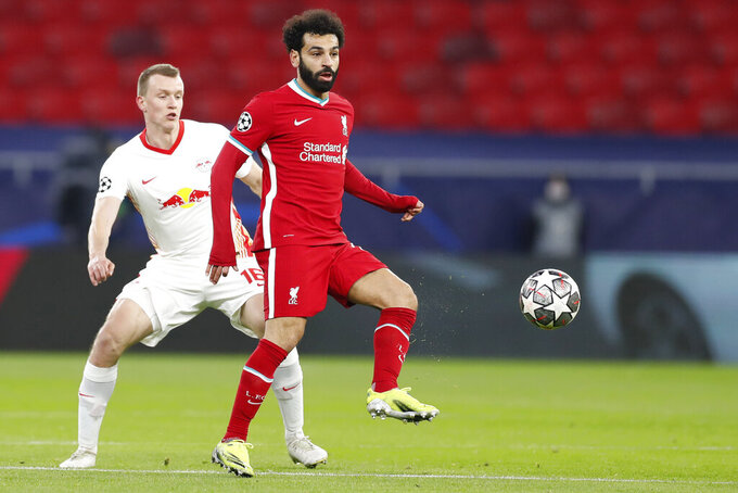 Liverpool's Mohamed Salah, right, is challenged by Leipzig's Lukas Klostermann during the Champions League round of 16 second leg soccer match between Liverpool and RB Leipzig at the Puskas Arena stadium in Budapest, Hungary, Wednesday, March 10, 2021. (AP Photo/Laszlo Balogh)