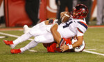 Arizona quarterback Rhett Rodriguez (4) is sacked by Utah defensive end Caleb Repp, bottom, during the second half of an NCAA college football game Friday, Oct. 12, 2018, in Salt Lake City. (AP Photo/Rick Bowmer)