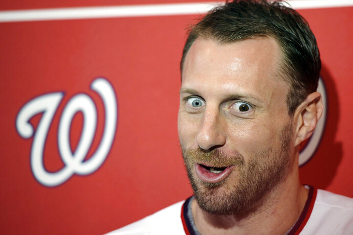Washington Nationals pitcher Max Scherzer talks with members of the media during the team's