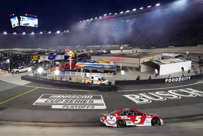 Kyle Larson drives through a turn during his win in a NASCAR Cup Series auto race at Bristol Motor Speedway Saturday, Sept. 18, 2021, in Bristol, Tenn. (AP Photo/Mark Humphrey)