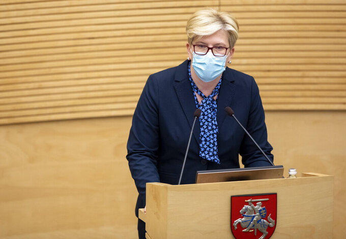 Lithuania's Homeland Union and Lithuanian Christian Democrats party leader Ingrida Simonyte speaks in parliament in Vilnius, Lithuania, Tuesday, Nov. 24, 2020. Lithuania's parliament approved Ingrida Simonyte as the new prime minister on Tuesday. (AP Photo/Mindaugas Kulbis)