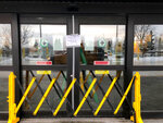 A closed entrance at the north terminal at Ted Stevens Anchorage International Airport in Anchorage, Alaska, where a flight plane carrying U.S. citizens being evacuated from Wuhan, China is expected later Tuesday, is seen Tuesday, Jan. 28, 2020. (AP Photo/Mark Thiessen)