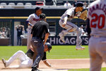 Minnesota Twins shortstop Andrelton Simmons, right, throws out Chicago White Sox's Yasmani Grandal at first after forcing out Jose Abreu at second during the first inning of a baseball game in Chicago, Thursday, July 1, 2021. (AP Photo/Nam Y. Huh)