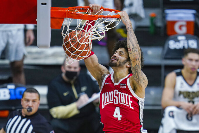 Ohio State guard Duane Washington Jr. (4) gets a basket on a dunk against Purdue in the first half of an NCAA college basketball game at the Big Ten Conference tournament in Indianapolis, Friday, March 12, 2021. (AP Photo/Michael Conroy)