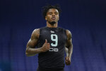 FILE - In this March 1, 2020, file photo, LSU defensive back Kristian Fulton runs the 40-yard dash at the NFL football scouting combine in Indianapolis. Fulton is a possible pick at the NFL Draft which runs Thursday, April 23, 2020 thru Saturday, April 25. (AP Photo/Michael Conroy, File)